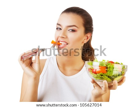 sexy fresh woman eating salad on white background - stock photo