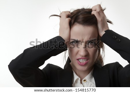 sexy frustrated woman office worker pulling out her hair not very happy - stock photo