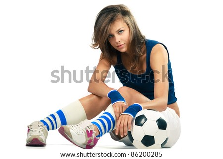 Sexy girl doing fitness, abdominal exercises with soccer ball over white background - stock photo
