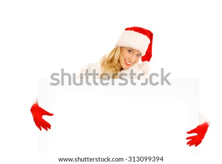 Sexy Girl dressed as Santa Claus Points Finger to Advertising Space