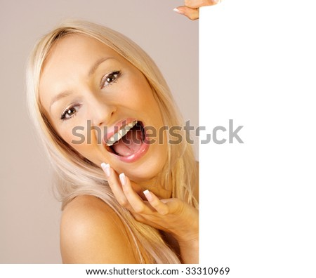 sexy girl holding blank billboard - stock photo