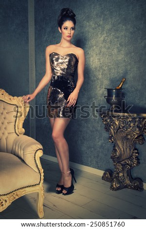 sexy girl in a golden sequined dress - stock photo