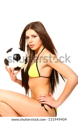 Sexy girl in a swimsuit with a soccer ball - stock photo