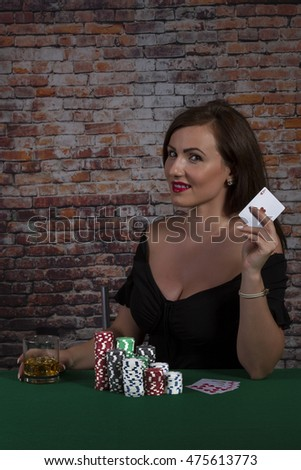 Sexy Girl in black dress with casino chips an money on red brick wall background