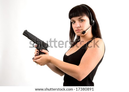 Sexy girl in black dress with gun and headphones. - stock photo