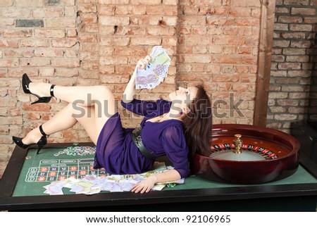 Sexy girl in casino - stock photo