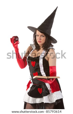 sexy girl in Halloween witch bewitches an apple - stock photo