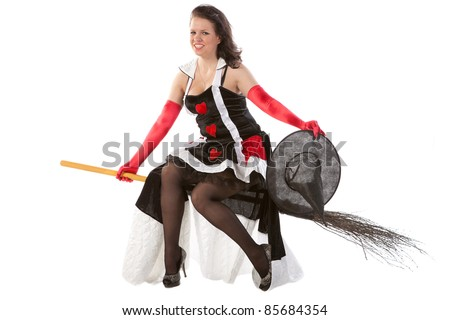 sexy girl in Halloween witch flying on a broom - stock photo