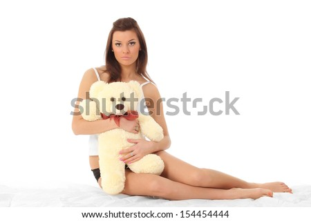 sexy girl in lingerie with a teddy bear
