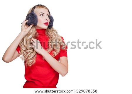Sexy Girl in red clothes and warm fur headphones red lips, Beautiful Blonde on a white background