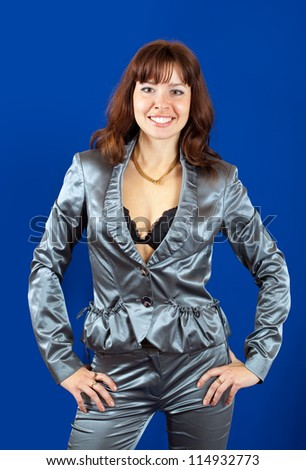 sexy girl in silver suit over blue background