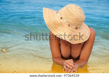 Sexy girl is lying down on the beach. - stock photo
