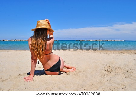 Sexy girl looking at the sea