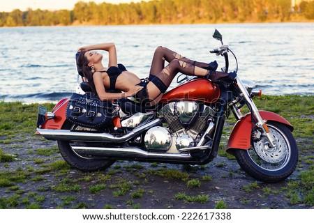 Sexy girl motorcycle stockings - stock photo