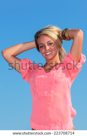 Sexy girl on beach wearing pink top - stock photo