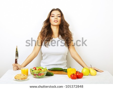 sexy girl on kitchen with knife - stock photo