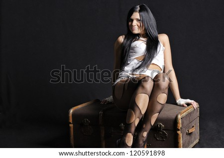 Sexy girl on suitcase