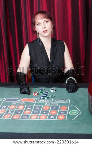 Sexy girl playing in casino - stock photo