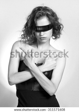 Sexy girl portrait making gun gestures black and white