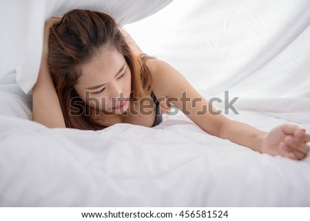 sexy girl poses in white bed sheets