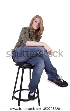 Sexy Girl Posing on a Chair - Isolated Background - stock photo