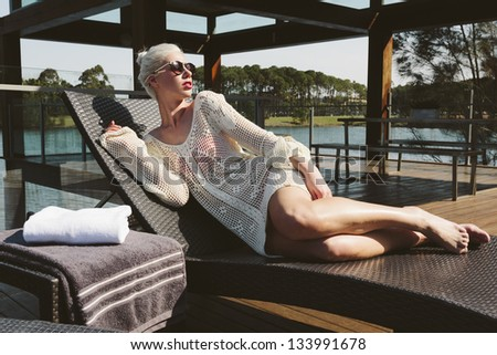 Sexy girl relaxing on sunbed - stock photo