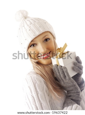 sexy girl smiles and holding a gift in packing - stock photo