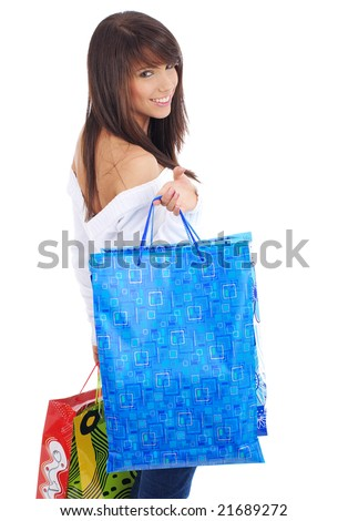 sexy girl smiles and holding a shopping bag