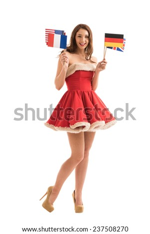 Sexy girl wearing Santa Claus clothes holding national flags - stock photo