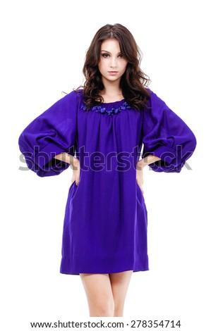 Sexy girl wearing sundress blue dress on dark background - stock photo