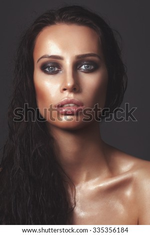 Sexy girl. Wet beauty portrait studio.