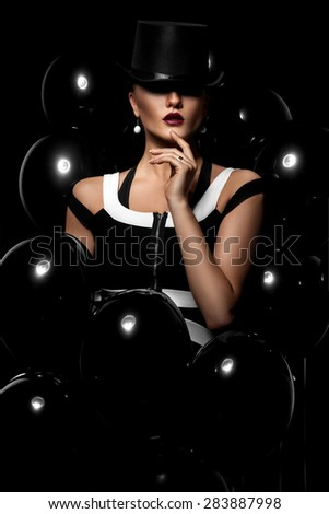 sexy girl with a hat in balloons
