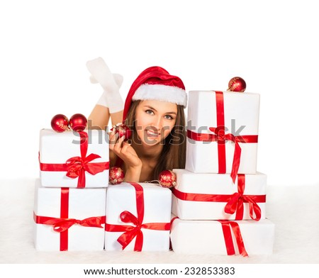 sexy girl with Christmas gifts lying on the carpet, smiling and looking at the camera