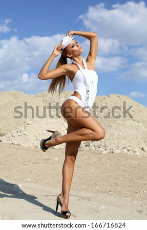 sexy girl with perfect body on the beach - stock photo