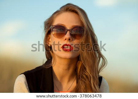 Sexy girl with sunglasses.Fashionable girl with sunglasses.Beautiful,stunning girl with brown sunglasses.Attractive,sexual,pretty,nice,adorable model,girl with branded sunglasses,modern,gorgeous girl. - stock photo