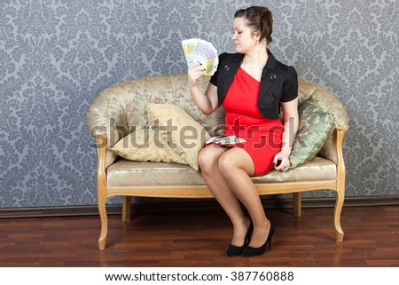 sexy girl with wads of 500 and 200 euros - stock photo
