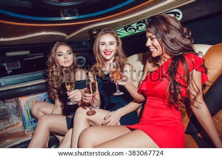 Sexy girls. Party in the car. Limousine.