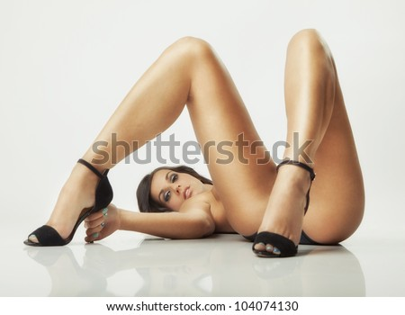 sexy glamour pose girl lying on white floor - stock photo