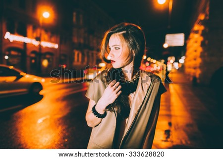 Sexy gorgeous brunette girl portrait in night city lights. Motion effect. - stock photo