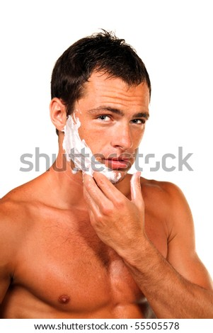 Sexy handsome young man with a shaving foam - stock photo