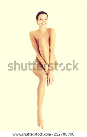 Sexy happy fit naked woman with healthy clean skin, isolated on white background - stock photo