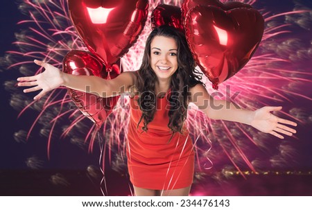 Sexy happy woman with balloons over fireworks background