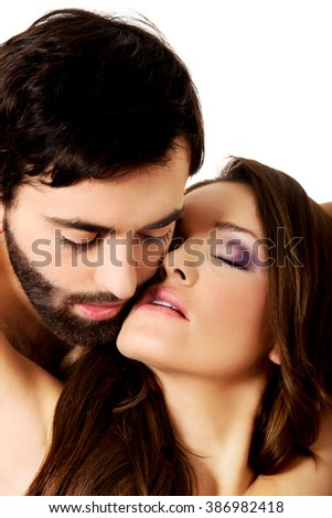 Sexy heterosexual couple embracing.