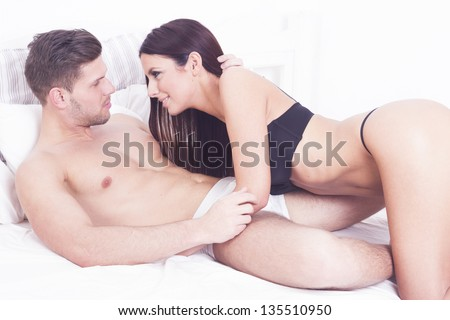 Sexy heterosexual passion couple on the bed - stock photo