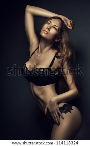 sexy hot woman in black lingerie in dark