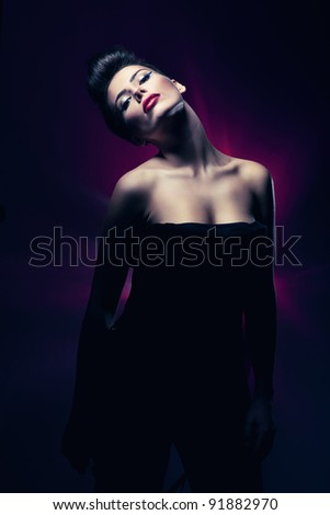 sexy hot woman with red lips in dark magenta light - stock photo