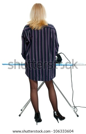 sexy housewife dressed in men's shirt ironing clothes - stock photo