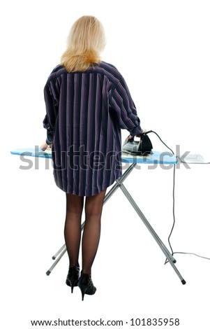 Sexy housewife ironing clothes on a white background