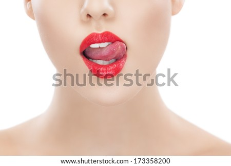 Sexy image of unrecognisable women with tongue licking upper lip. Studio shot. Retouching taken with special care.