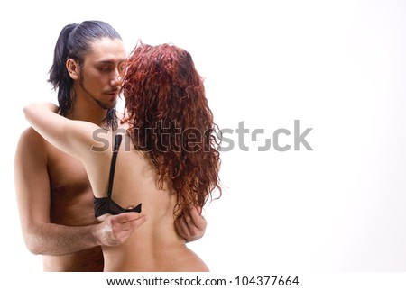 Sexy isolated couple of with red hair woman